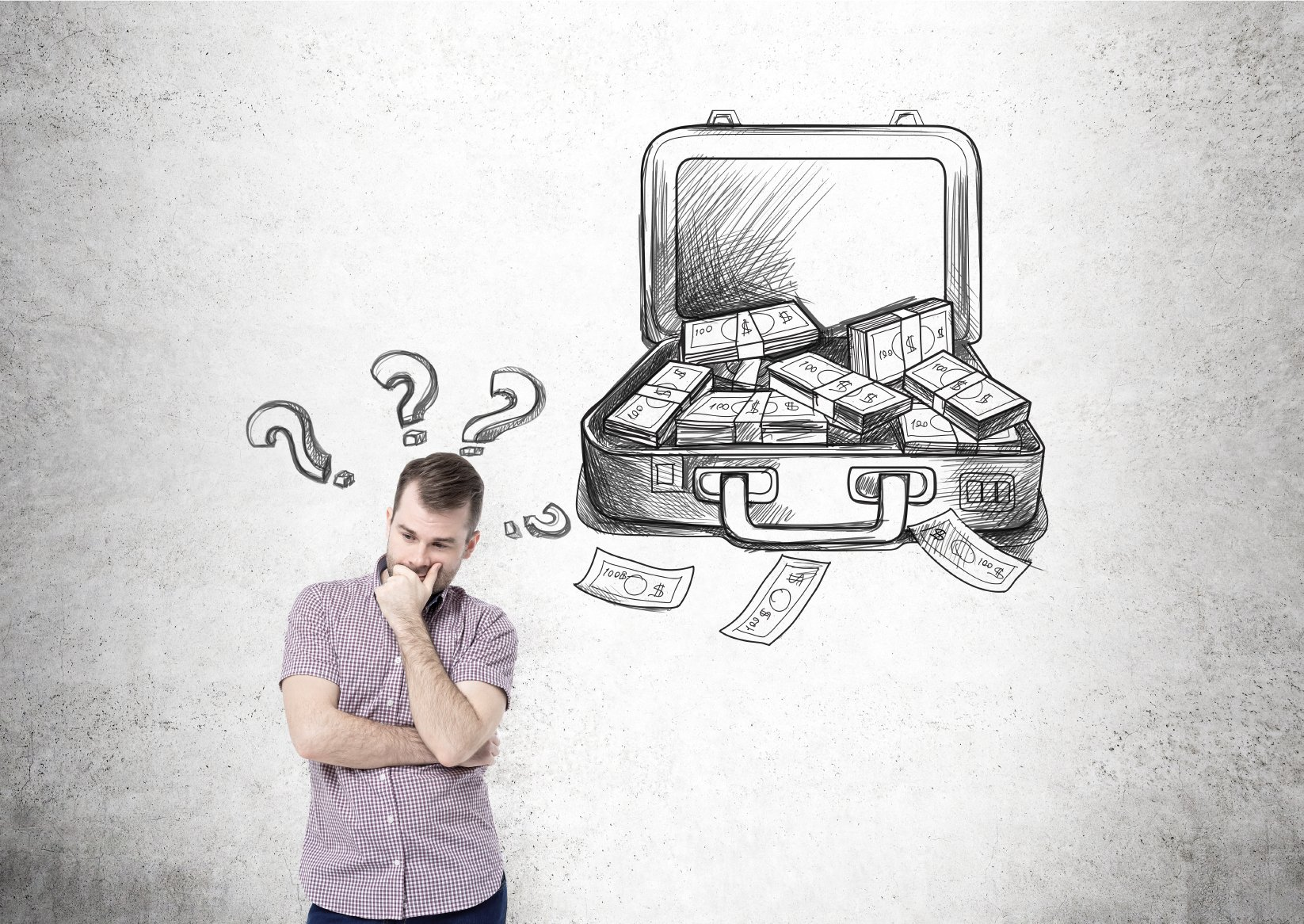 Businessman with hand at chin, open case with money drawn on concrete wall behind, question marks over his head. Concept of making money.